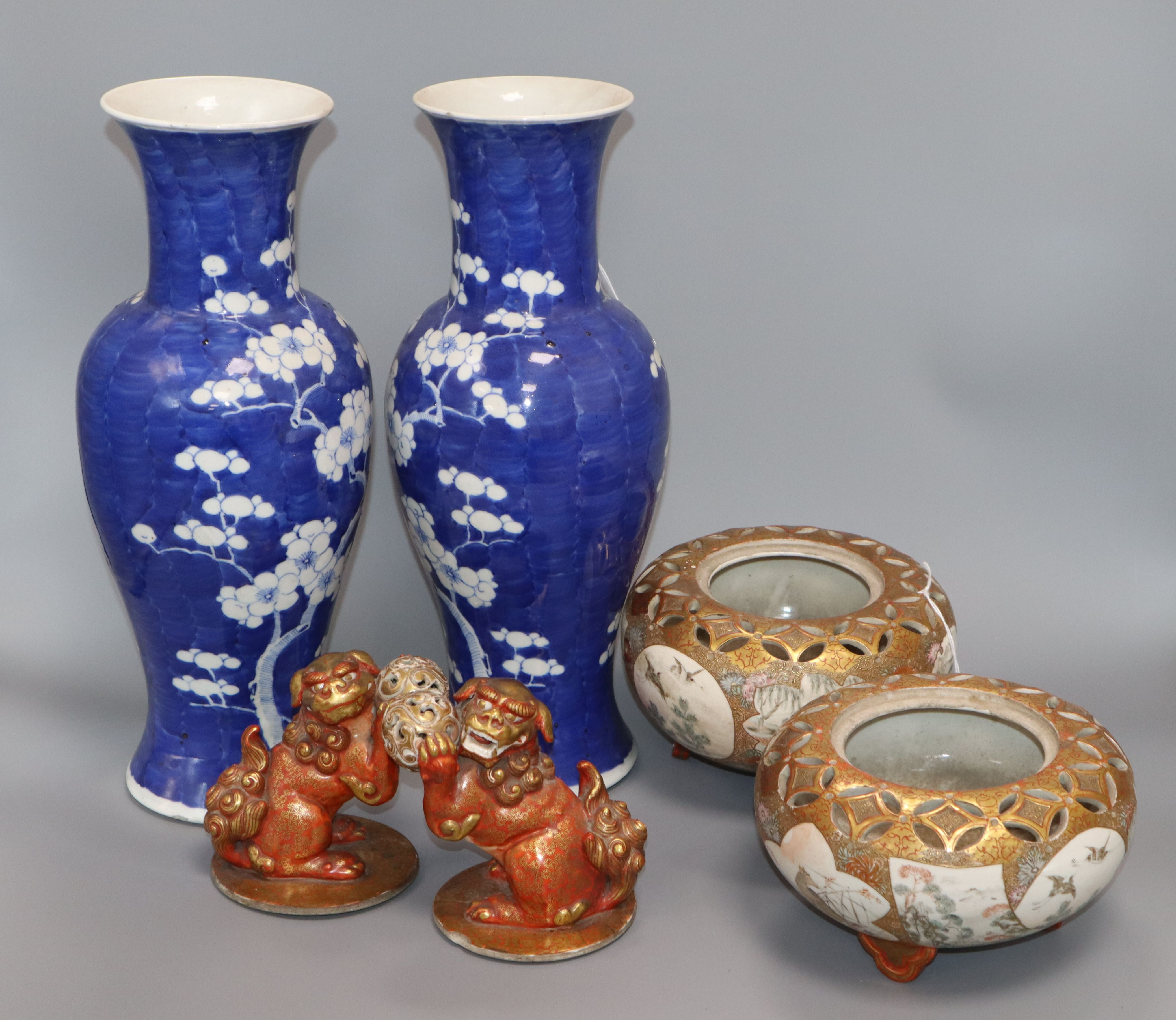 Lot 21 - A pair of 19th century Chinese vases, decorated with prunus on a blue ground and two matching Kutani