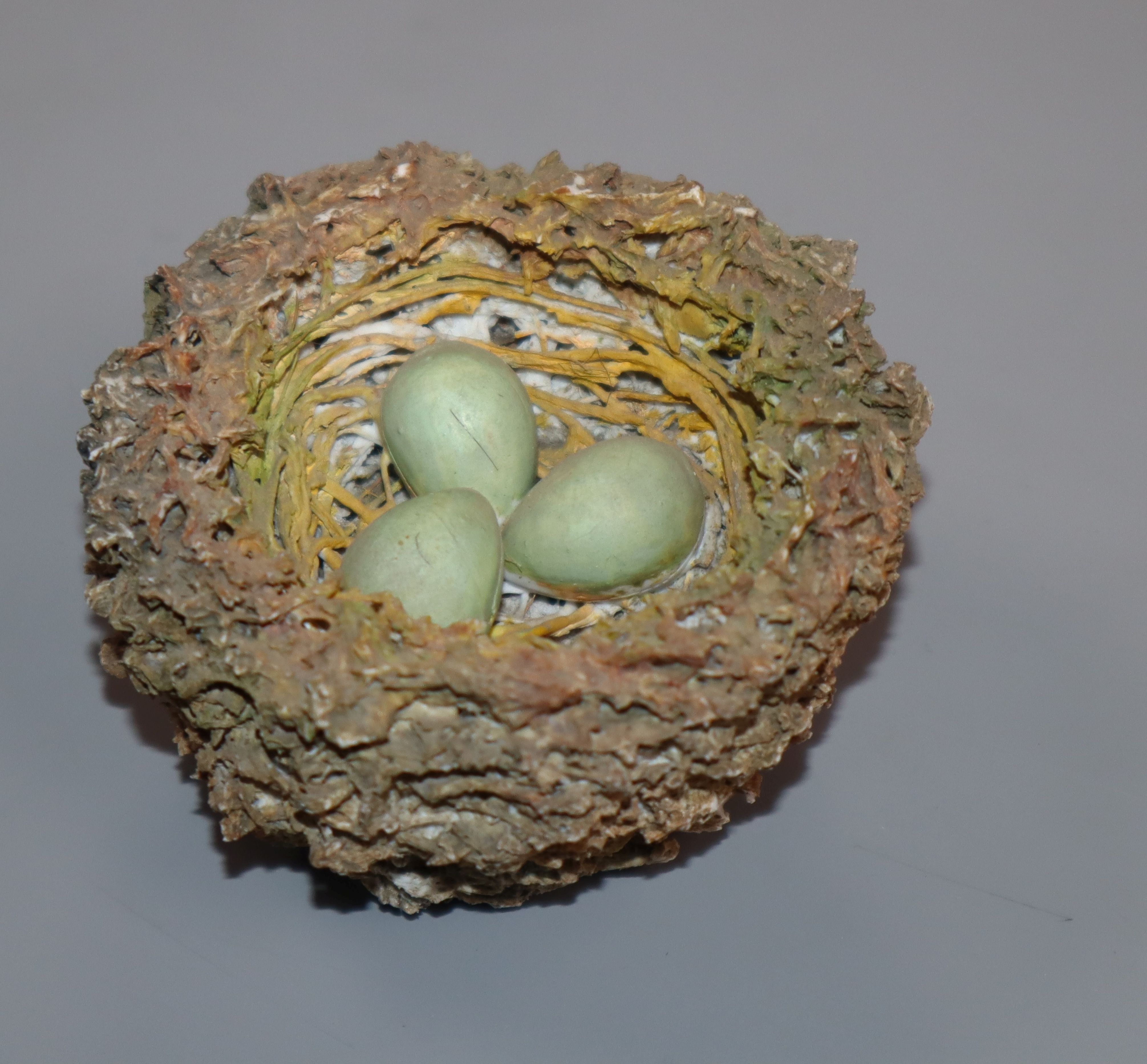 Lot 275 - A Bristol porcelain model of a bird's nest, modelled by Edward Raby for Pountney & Co, in moss