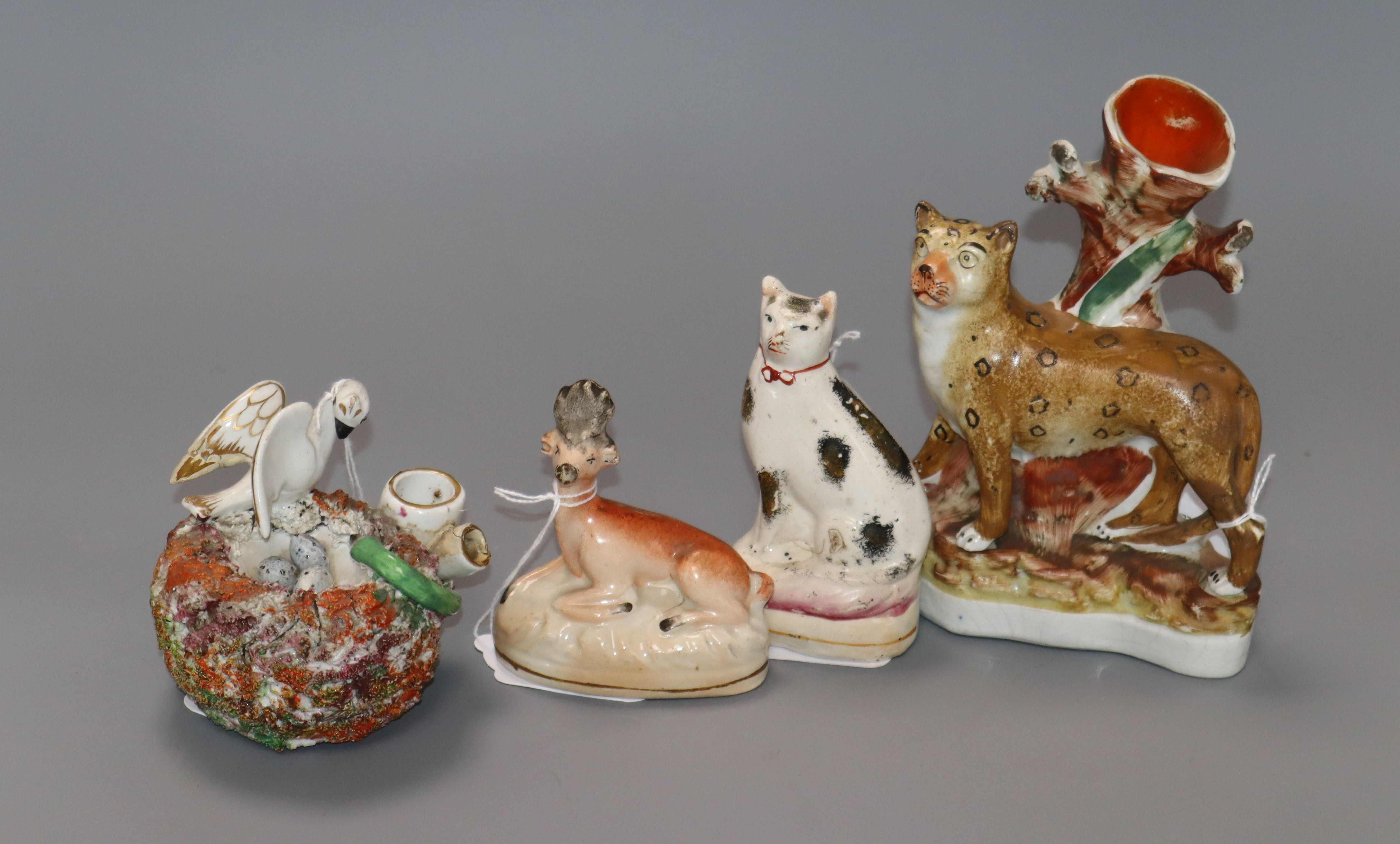 Lot 88 - A 19th century Staffordshire spill vase modelled as a leopard and three other Staffordshire