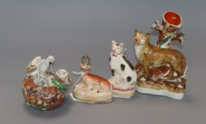 A 19th century Staffordshire spill vase modelled as a leopard and three other Staffordshire
