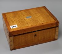 A 19th century satinwood jewellery box