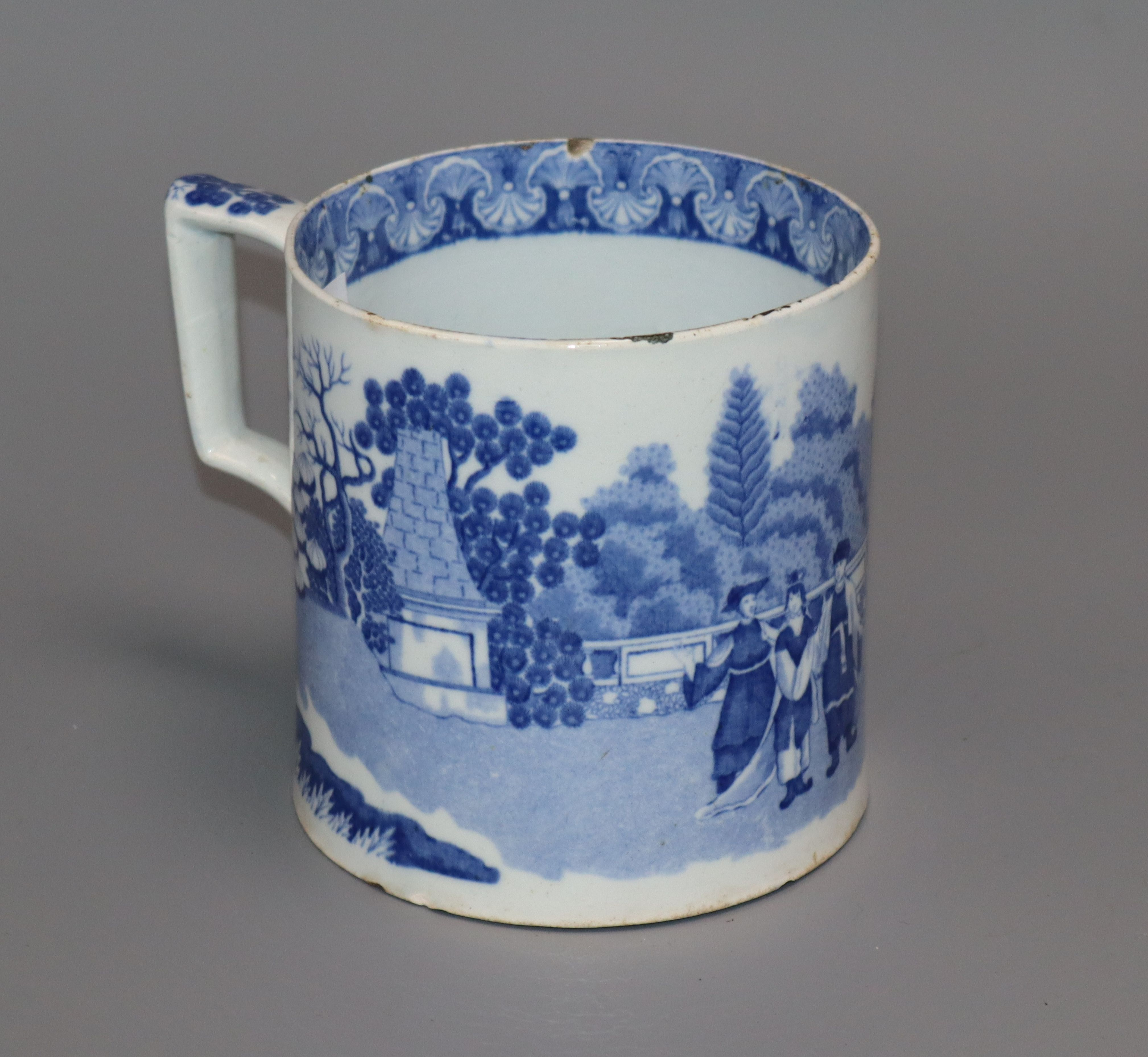 Lot 7 - A blue and white pearlware mug height 12cm