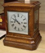 A Victorian oak mantel clock striking on gong height 34cm