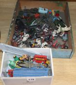 A quantity of farmyard animals and toy cars
