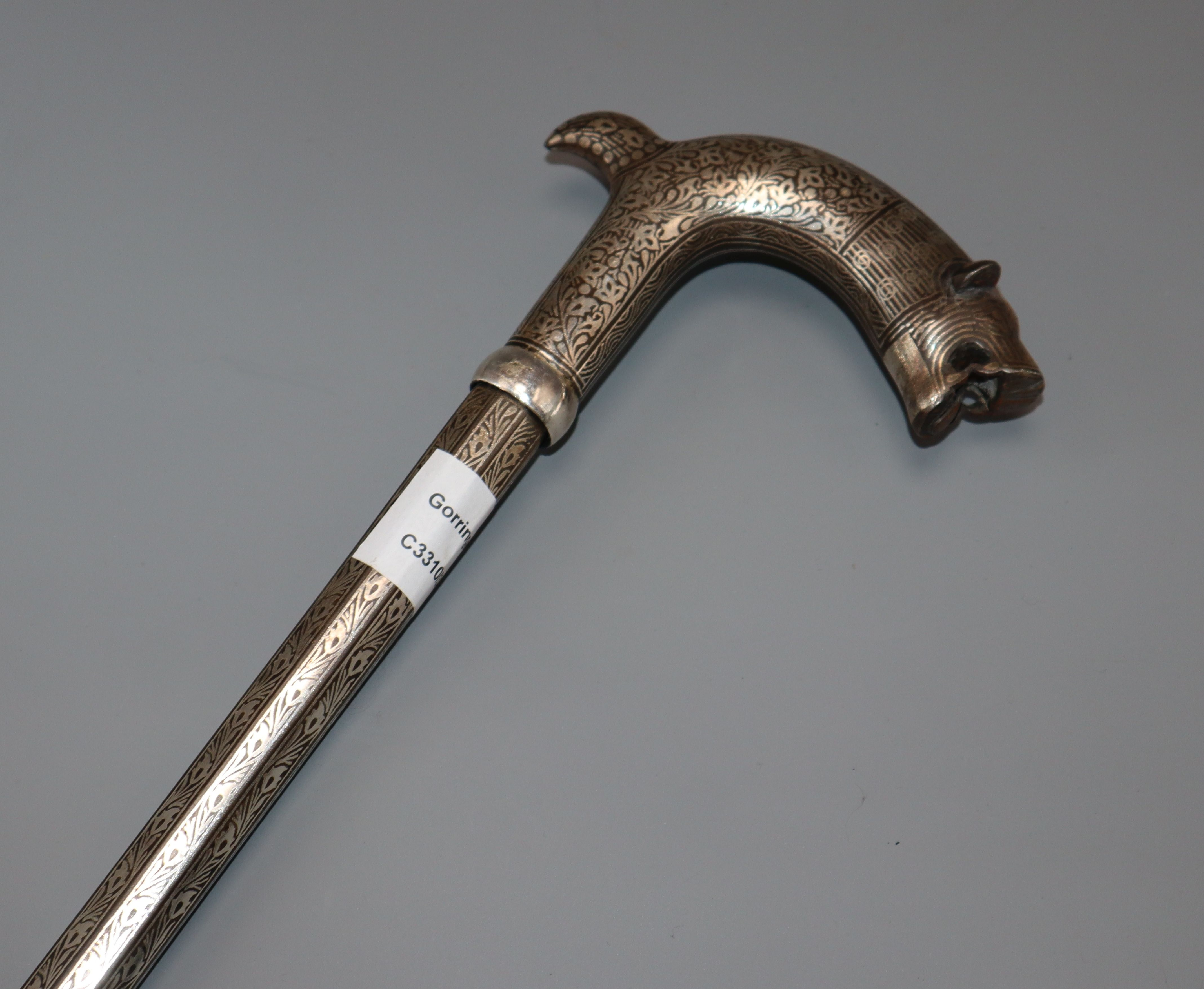 Lot 26 - A 19th century bidri ware mahout elephant tamer's stick, with tiger's head handle and decorated with