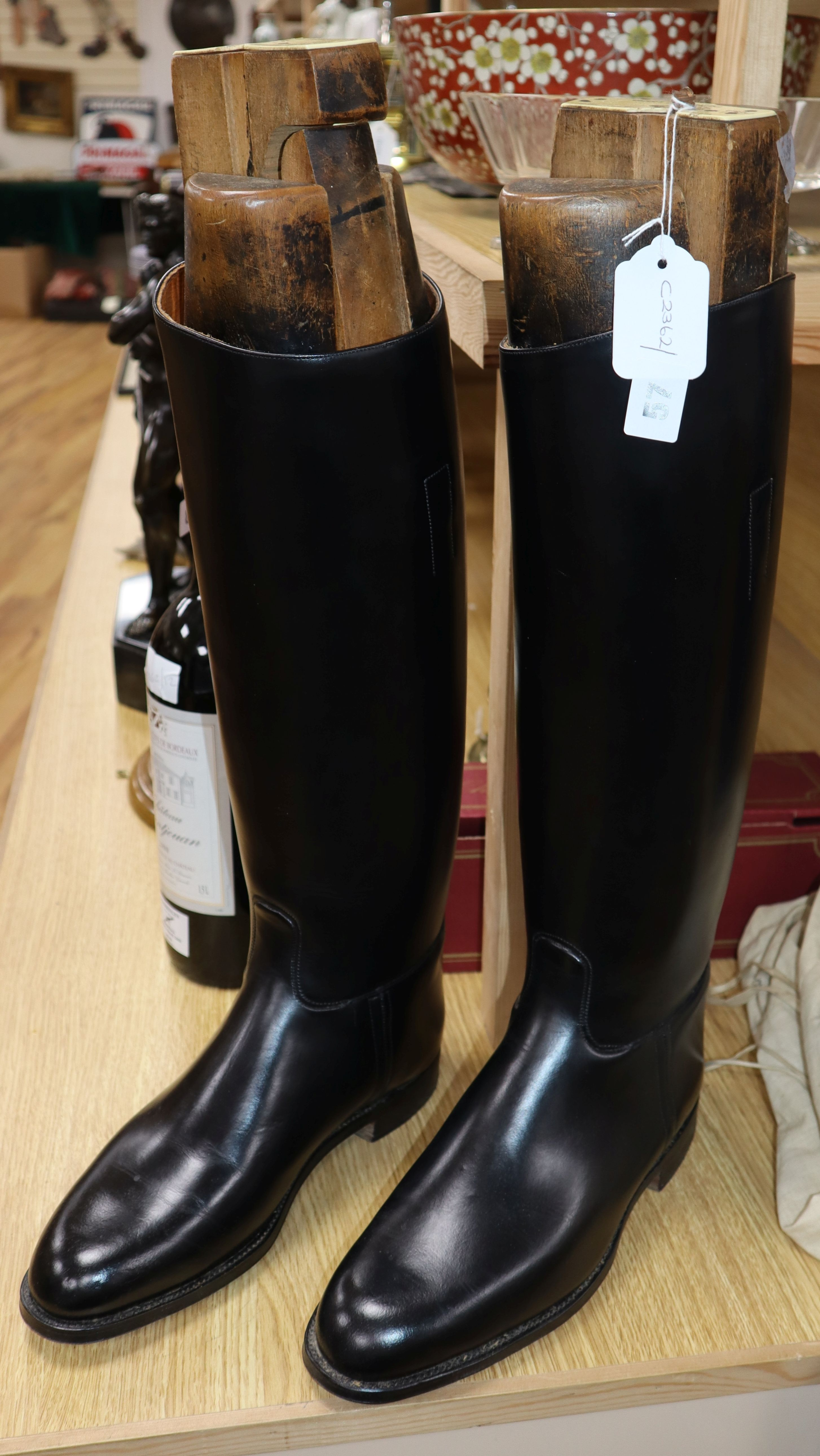 Lot 57 - A pair of black leather riding boots, the trees bearing ivorine plaques inscribed 'Viscount