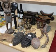 A quantity of African carvings including head-rests, masks and metalwares