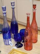 Two blue overlay glass decanters and stoppers, two ruby flask glass decanters and a pair of blue