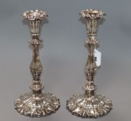 A pair of plated candlesticks height 29cm