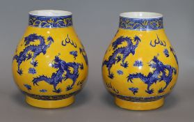 A pair of Chinese yellow ground dragon vases height 19cm