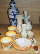 Three Shelley coffee cups and saucers and a group of Belleek and Goss tallest 28cm