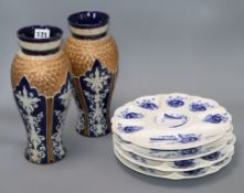 A pair of Royal Doulton vases and four blue and white Victorian oyster plates vases 28cm