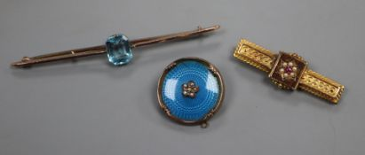 A late Victorian 15ct gold and gem set bar brooch, one other brooch and a 9ct gold and enamelled