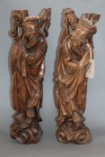 A pair of Chinese carved hardwood figures of sages height 53cm