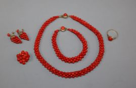 Assorted coral jewellery, including necklace, bracelet, pair of earrings and a brooch.