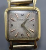 A lady's 750 yellow metal Jaeger le Coultre manual wind wristwatch(a.f.), on associated rolled