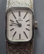 A lady's 9ct white gold Omega manual wind wristwatch, on integral textured 9ct white gold Omega