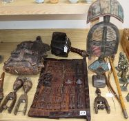 A group of African tribal carvings and bronze figures