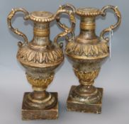 A pair of Portuguese colonial silvered and giltwood vases/candlesticks height 40cm