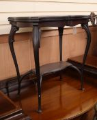 A late Victorian mahogany folding top card table, on cabriole legs W.62cm