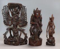 Three Balinese hardwood carvings tallest 31cm