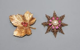 Two 9ct gold and gem set foliate brooches, largest 29mm.