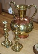 A large brass urn, height 32.5cm and a pair of brass candlesticks