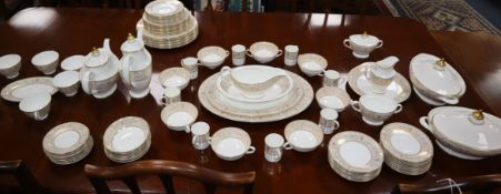 A Royal Doulton Sovereign pattern dinner and tea service, the vast majority for eight settings
