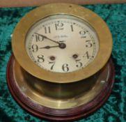 A brass bulkhead clock