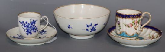 A Worcester blue flower sprigged coffee cup and saucer and matching slops bowl,c. 1770, the saucer