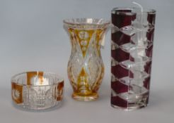 A French ruby overlay faceted glass vase, stamped 'France' to base and two other items, a yellow