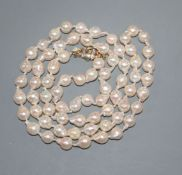 A modern single strand cultured baroque pearl necklace, with 9ct gold and diamond chip set clasp,