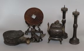 A group of Chinese bronzes, 19th/20th century, including a censer and cover, a flat iron, a lion-