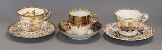 Three Chamberlain Worcester tea or coffee cups and saucers, early 19th century, the floral example