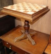 An onyx topped games table W.55cm