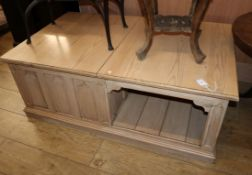 A pitch pine hinged top coffee table W.122cm
