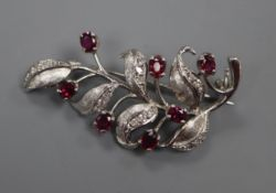 A modern 18ct white gold, ruby, diamond set leaf brooch, 41mm.