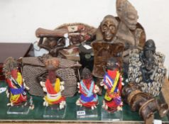 A quantity of ethnographical carvings, beadworks, metalwares and animal hides