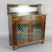 A William IV brass mounted rosewood chiffonier, with three quarter gallery, mirrored back, two