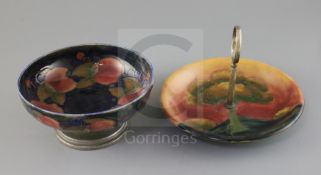A Moorcroft 'pomegranate' and Tudric pewter mounted bowl and an 'Eventide' cake dish, c.1920-5,