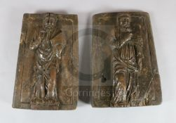 A pair of 18th century Continental carved wood panels, depicting saints, W.12in. H.16.5in.