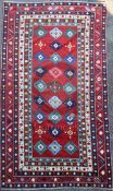 A Lambalo Kazak Caucasian small carpet, the red field woven with three rows of stylised floral