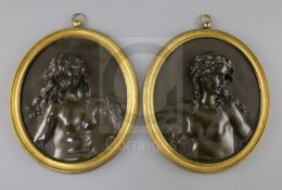 A pair of 19th century French bronze oval relief plaques of Bacchanalian women, in ormolu frames,