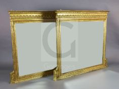 A pair of Edwardian giltwood and gesso overmantel mirrors, decorated with foliate motifs and centred