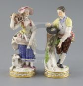 Two Meissen figures of a boy with a bird nest and girl with a bird cage, late 19th century, each