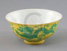 A Chinese yellow ground 'dragon' bowl, probably Qianlong mark and period, with incised green dragons