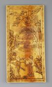 A Chinese ivory plaque, Qing dynasty, carved in relief with a sage and a lady in a pavilion