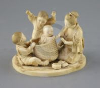 A good Japanese ivory okimono of a lady and children playing, Meiji period, with two boys scaring