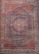 An antique Malayer carpet, dated 1905, with central medallion in a field of geometric motifs and