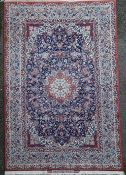 A fine Tabriz blue ground rug, with farsi inscription and central medallion in a field of